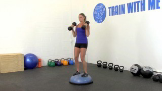 Female exercising - bosu bicep curl press