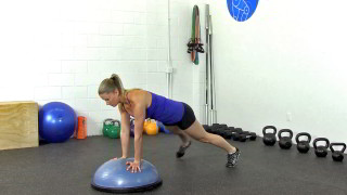 Female exercising - bosu push-up plank alternating toe taps