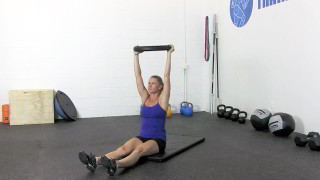 Female exercising - weighted sit-ups