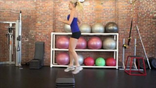 Female exercising - aerobic step-ups