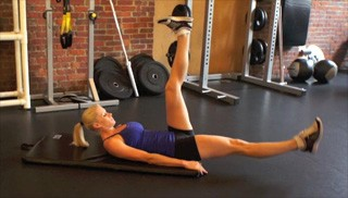 Picture of a female doing Alternating Leg Drops Exercise