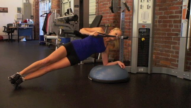 Female exercising - bosu side plank row