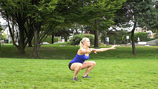 Female exercising - outdoor air squats