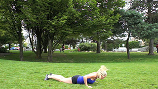 Female exercising - outdoor burpees