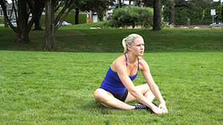 Female exercising - outdoor butterfly sit-ups