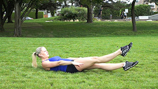 Female exercising - outdoor fludder kicks