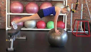 Picture of a female doing Push Up Plank w/ Stability Ball Exercise