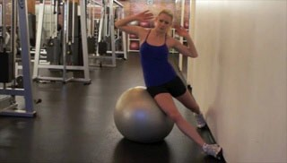 Picture of a female doing Side Crunches with Stability Ball Exercise