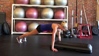 Female exercising - straight arm plank-ups