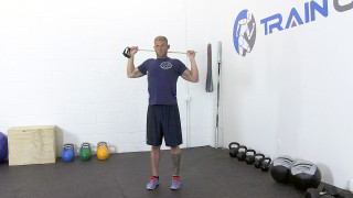 Male exercising - behind the neck band pulls
