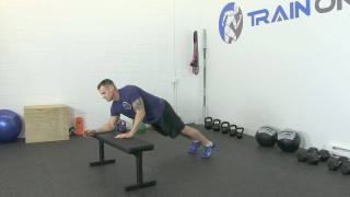 Male exercising - bench plank to push-up