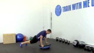 Male exercising - bosu burpee overhead press