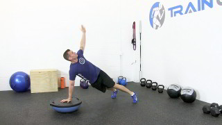 Male exercising - bosu push-up t-bar