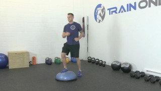 Male exercising - bosu step-ups