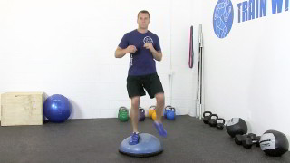 Male exercising - bosu straddle