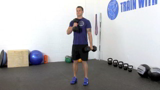 Male exercising - cross body dumbbell hammer curls