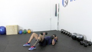 Male exercising - dumbbell floor press