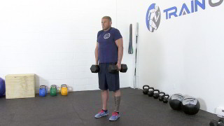 Male exercising - dumbbell shrugs