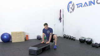 Male exercising - dynamic hip mobility on steps
