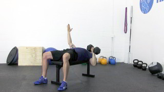 Male exercising - single side dumbbell chest press