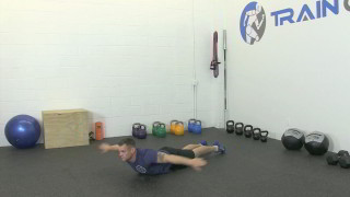 Male exercising - swan dive shoulder rotation