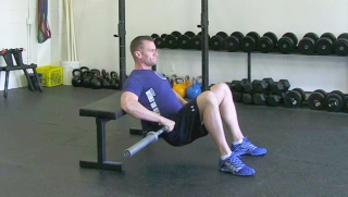 Weighted Glute Bridge On Bench exercise for men