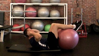 Picture of a male doing Ab Crunch w/ Stability Ball Exercise