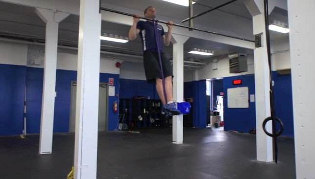Male exercising - assisted band pull-ups