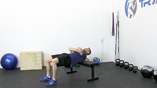 Male exercising - bench hip raise