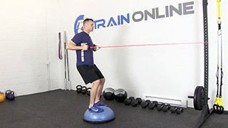 Male exercising - bosu band row