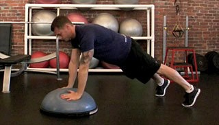 Picture of a male doing Bosu Plank to Push-Up Exercise