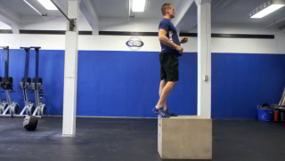 Male exercising - box step-ups