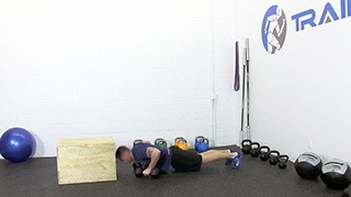 Male exercising - dumbbell burpee step-up