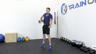 Male exercising - dumbbell hang snatch