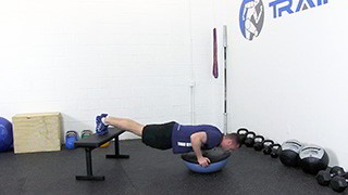 Male exercising - elevated bosu push-ups