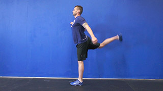 Male exercising - front leg swings