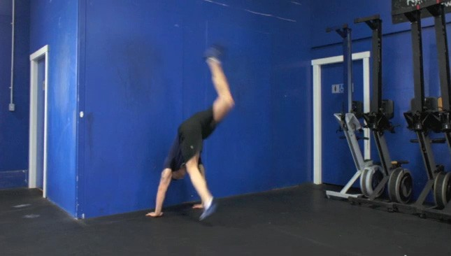 hand stand against wall exercise