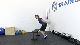 Male exercising - jump over bench