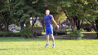 Male exercising - outdoor jump squats