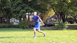 Male exercising - outdoor jumping split lunge