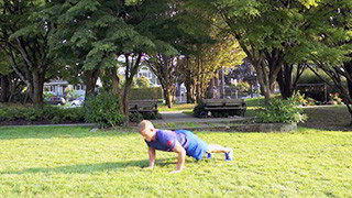 Male exercising - outdoor plyo push-ups