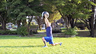 Male exercising - outdoor reverse lunge press