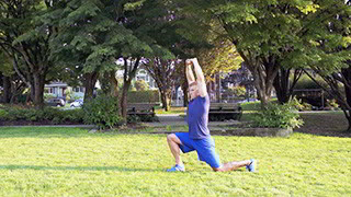 Male exercising - outdoor samson lunge
