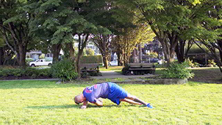 Male exercising - outdoor side plank twist