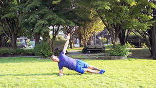Male exercising - outdoor side plank