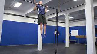 Male exercising - pull-ups