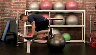 Picture of a male doing Stability Ball Knee Tucks on Bench Exercise