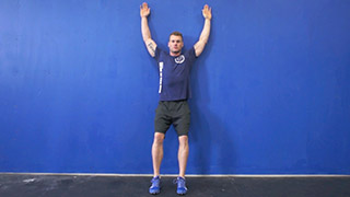 Male exercising - standing wall angels