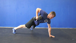 Male exercising - three point dumbbell row