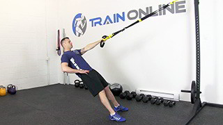 Male exercising - trx single arm row